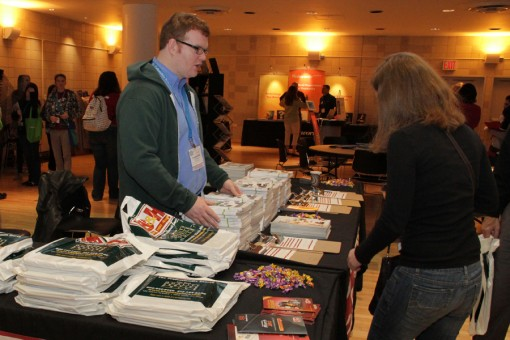 Exhibitors display their products and services to delegates.