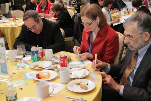 Delegates participate in an interactive activity during the 2012 Awards Luncheon.