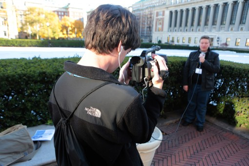 At the 2013 CSPA Fall Conference, student shoots a stand up for their newscast with Butler Library in the background. Photo by Mike Simons.