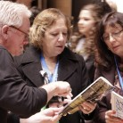 Delegates looking at the Columbia campus map at the 2014 High School Convention. Photo by Jake Palenske.